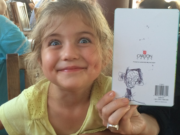 Imogin (Leslie and Sean's youngest) with a portrait she drew of her grandpa...hey, it does look a lot like me.